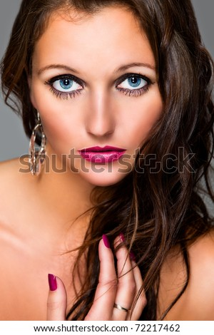 Attractive young girl with long brown hair and naked shoulders. Retouched