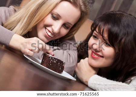 Attractive young girls with a pie - stock photo