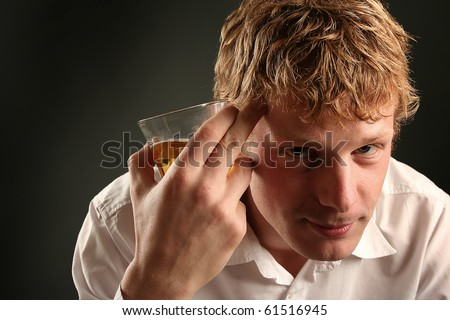 attractive young guy drinking whiskey - stock photo