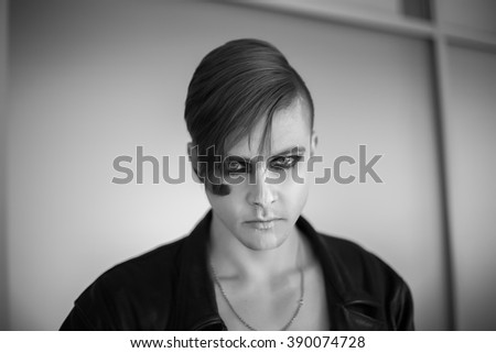 Attractive young guy posing in the stadium, black and white photo - stock photo
