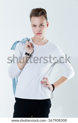 Attractive young handsome man. Studio fashion photo - stock photo