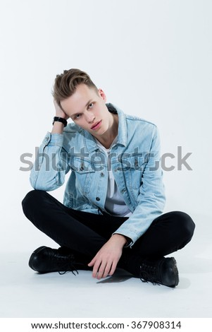 Attractive young handsome man. Studio fashion photo