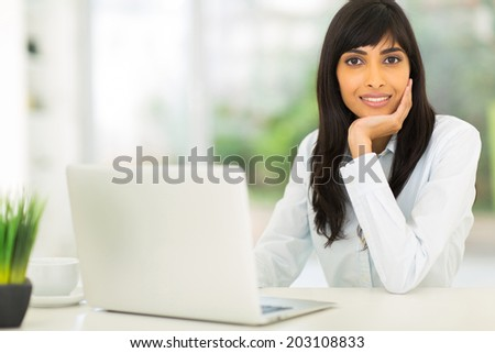 attractive young indian businesswoman in modern office