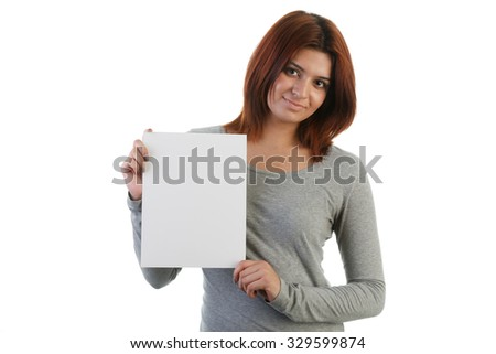 Attractive young Indian woman holding a placard - stock photo