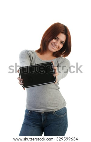 Attractive young Indian woman presenting what on a tablet - copyspace - stock photo