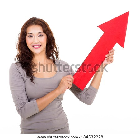 attractive young lady holding direction arrow pointing up
