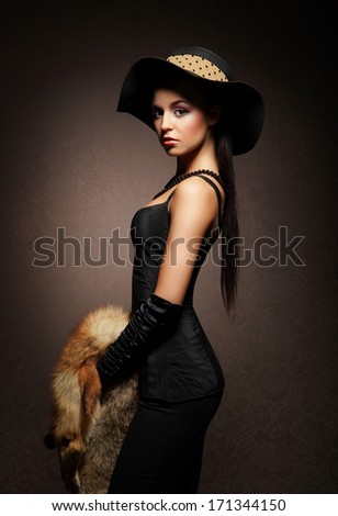 Attractive young lady over the retro background
