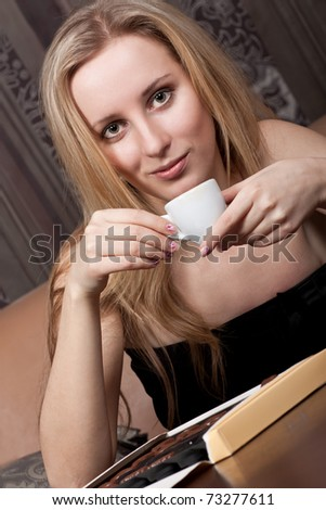 Attractive young lady with a cup of tea - stock photo