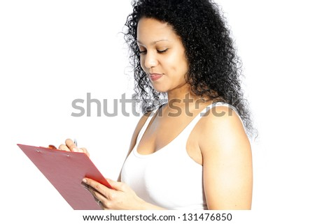 Attractive young lady with lovely curly black hair standing looking down at a white blank sign that she is holding in her hands - stock photo