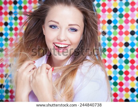 Attractive young laughing woman on spotted background, beauty and fashion concept  - stock photo