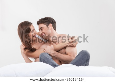 Attractive young lovers are resting at home - stock photo