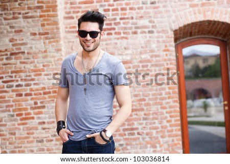 attractive young male model smiling - stock photo
