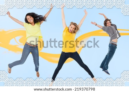 Attractive young man and women jumping for joy against snowflake frame - stock photo