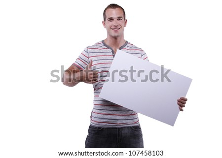 Attractive young man holding blank billboard. White background.