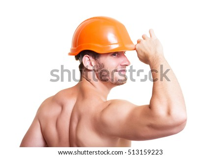 Attractive young man in an orange construction helmet, isolated on white background.