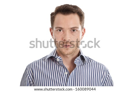 Attractive young man in blue shirt staring at camera - stock photo