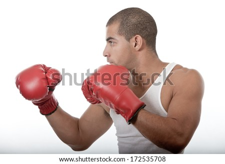 Attractive young man kickboxing - stock photo