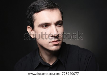 Attractive young man on black background
