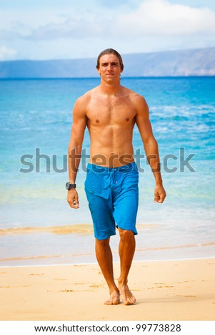 Attractive Young Man on Tropical Beach - stock photo