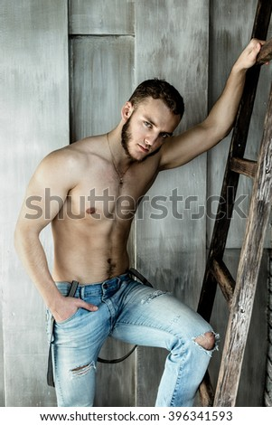 Attractive young Man posing wearing jeans