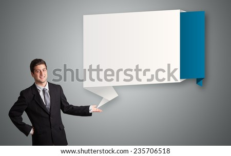attractive young man presenting modern origami copy space - stock photo