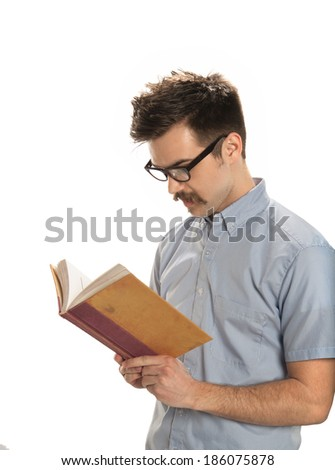Attractive young man reading an old book, isolated on white background - stock photo
