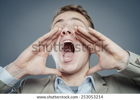 Attractive young man shouting - stock photo