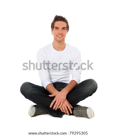 Attractive young man sitting. All on white background. - stock photo