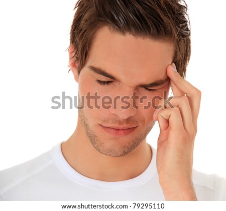 Attractive young man suffers from a headache. All on white background. - stock photo