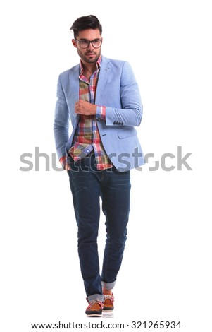 Attractive young man walking on isolated background with his hand in pocket. - stock photo