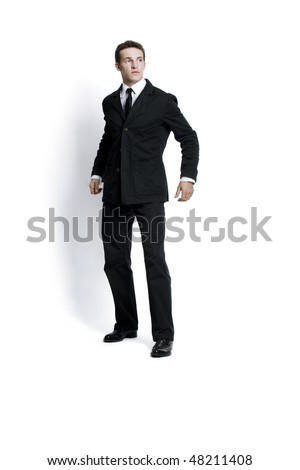attractive young man wearing elegant black suit. Isolated on white - stock photo