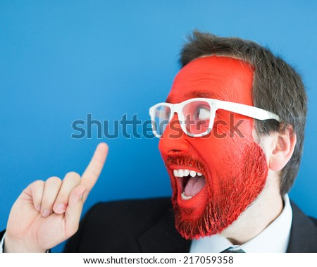 Attractive young man wearing glasses and pointing up - stock photo