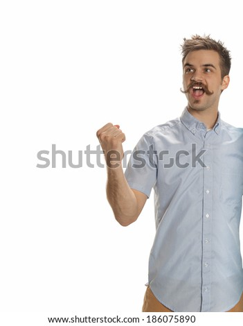 Attractive young man with a handlebar mustache playfully raises his fist in a challenge, isolated on white - stock photo