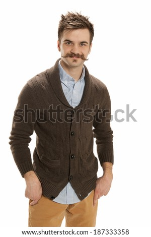 Attractive young man with his hands in his pockets, isolated on white background - stock photo