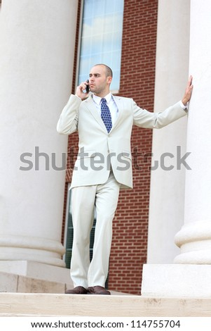 Attractive, Young Mature and Serious Professional Business Man Talking on the Phone