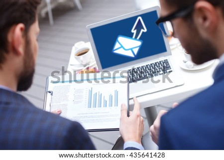 Attractive young men working on business project - stock photo