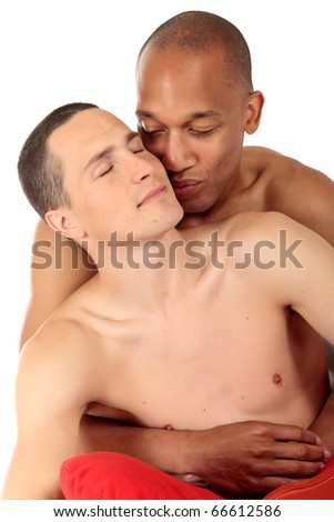 Attractive young mixed ethnicity gay, homosexual couple, Caucasian and African American men in the bedroom, grooming, celebrating valentines day.  Studio, white background.