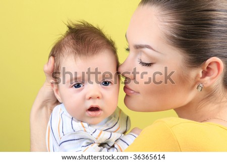 attractive young mother with 2 month baby boy