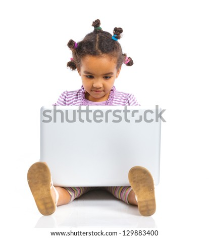 Attractive young mulatto girl using notebook computer. Isolated on white background. - stock photo