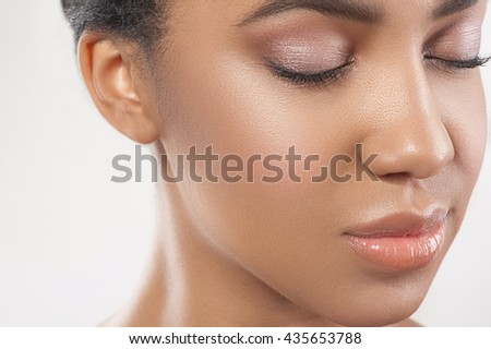 Attractive young mulatto woman with smooth skin - stock photo