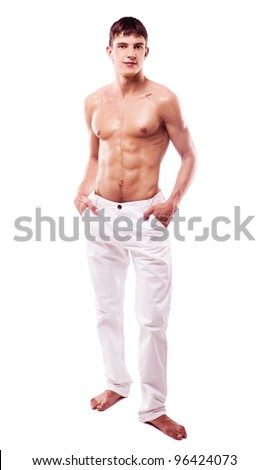 attractive young muscular man wearing jeans, isolated against white background - stock photo