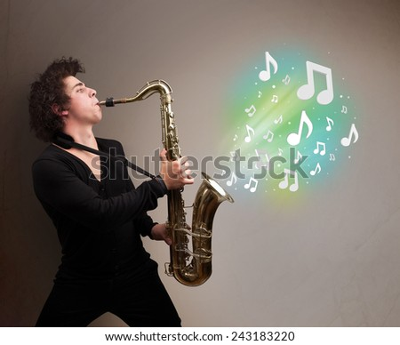 Attractive young musician playing on saxophone while musical notes exploding - stock photo
