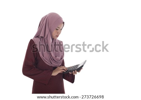 Attractive young muslimah businesswoman holding a calculator. - stock photo