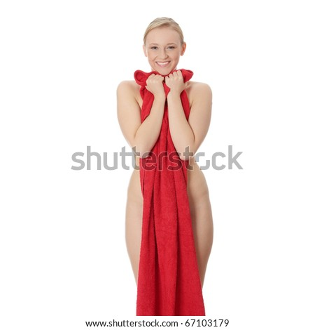 Attractive young nude woman covered by red towel, isolated on white - stock photo