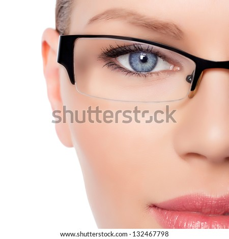 Attractive Young Optician Woman With Blue Eyes In Glasses - stock photo
