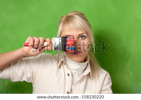Attractive young painter with a big brush - stock photo