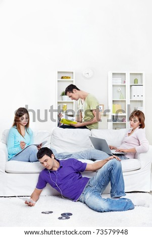 Attractive young people are engaged in a variety of activities at home - stock photo
