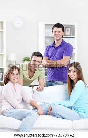 Attractive young people at home - stock photo
