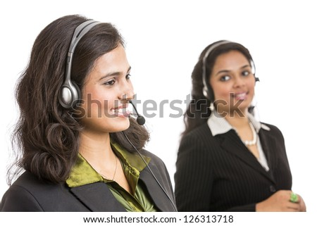Attractive young people working in a call center - stock photo