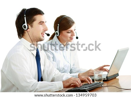 Attractive young people working in a call center isolated on white background